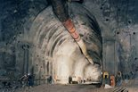 Workers advance construction on a tunnel at the facility