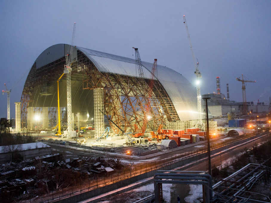 The New Safe Confinement arch was assembled in sections near the damaged reactor and slid into place on rails. Photo: European Bank for Reconstruction and Development