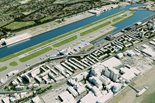 Aerial view of the London City Airport with planes, water, and grass