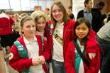 four young girls in girl scouts uniforms pose for a picture