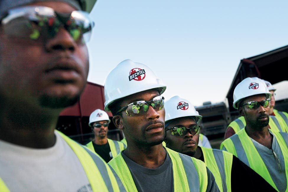 Workers attend a safety briefing; Bechtel employed 2,600 people at peak, with the majority from Mississippi and other Gulf states