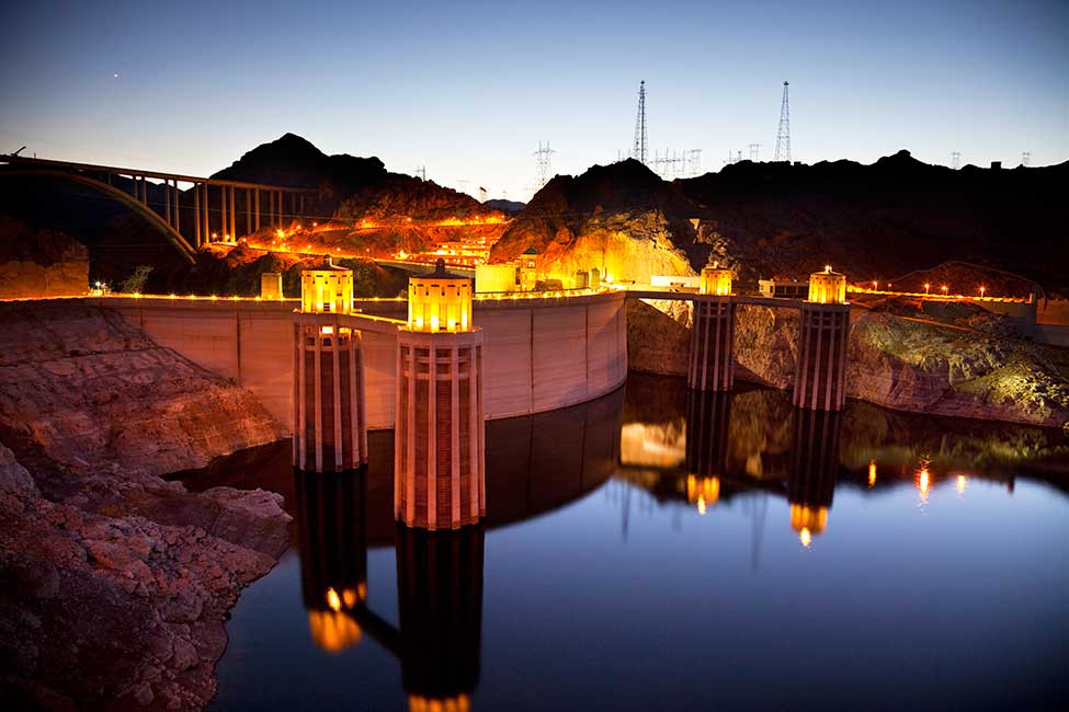 Night falls on the dam's intake towers