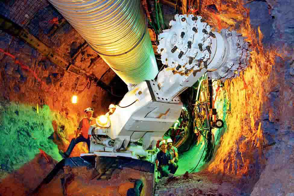 Workers operate a tunneling machine at the facility in order to study the mountain's rock, water movement and susceptibility to earthquakes