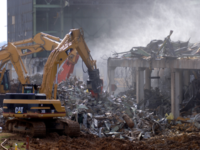 An excavator tears down the K-25 building