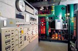 Control panel in a room with piping.