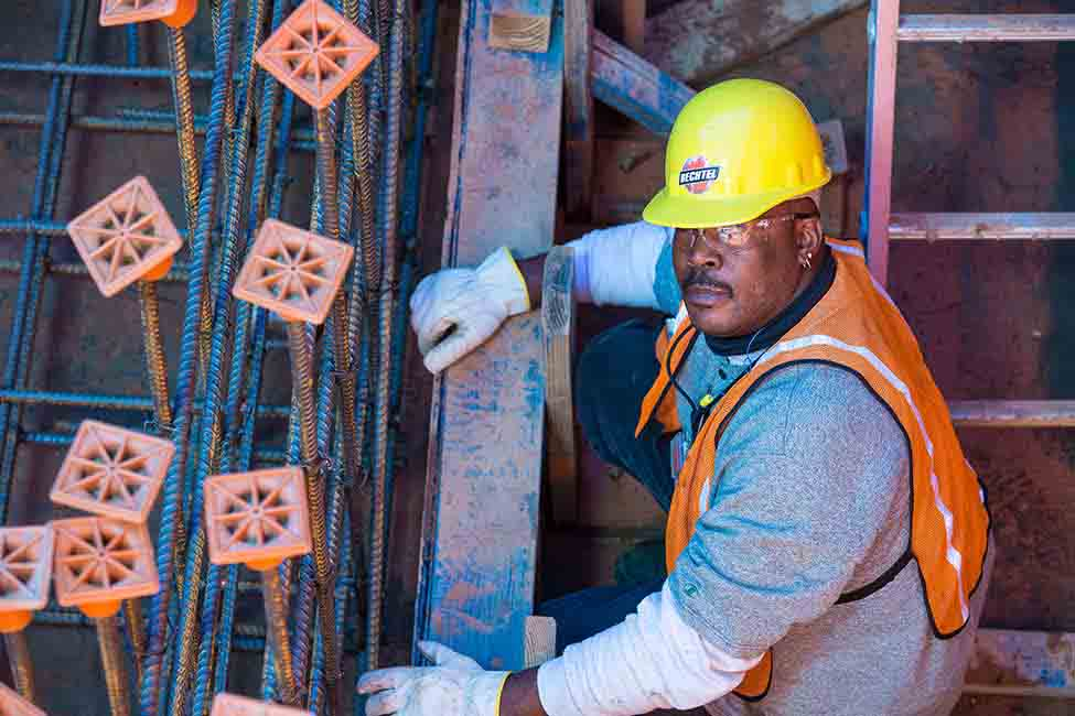 A worker performs rebar installation
