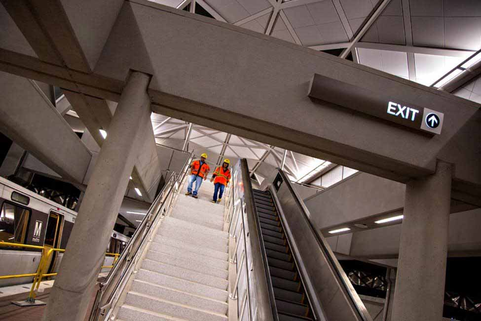 Workers review progress at one of the Dulles Corridor Metrorail five stations