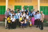 A number of Bechtel employees pose with a large group of school children