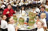 A group of students eat lunch with two Bechtel employees