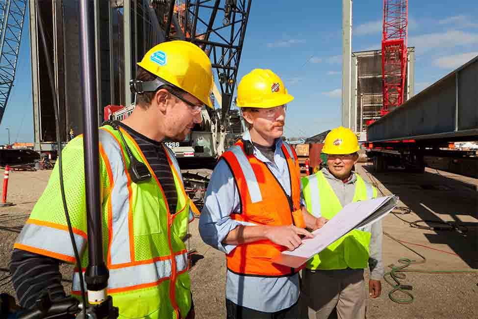 Project engineers review the power plant's steam generator