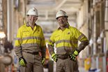 two employees pose at Wheatstone