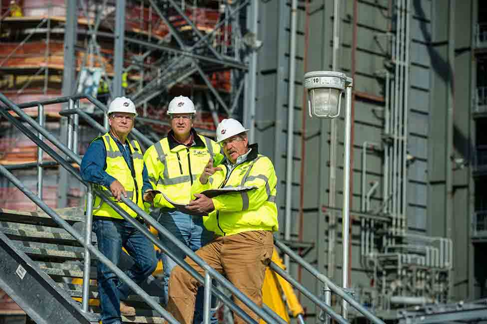 Project workers conduct a field review