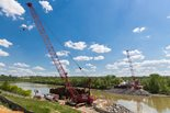 cranes and equipment near body of water