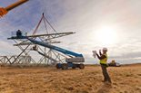 A Bechtel right-of-way field coordinator supervises a tower assembly