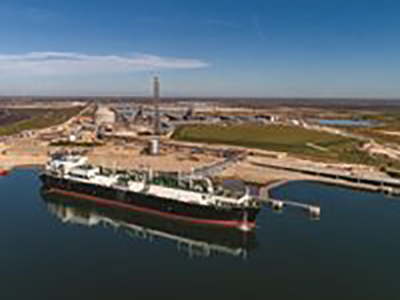 image of a LNG tank facility on the water